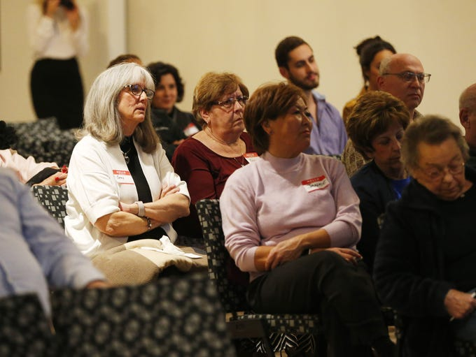 A crowd listens during a forum for superintendent candidates