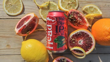 Dogfish Head cans Flesh & Blood IPA