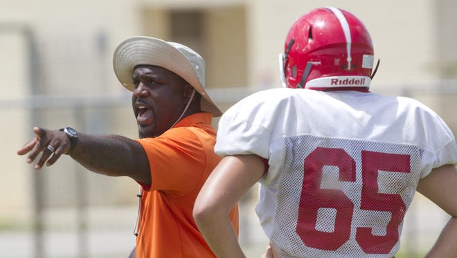North Fort Myers High School head football coach Earnest Graham instructs his players during defensive drills Tuesday, August 29 in North Fort Myers.