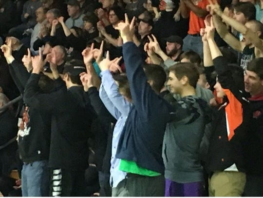 The Marshfield student section celebrate Tanner Kanable's