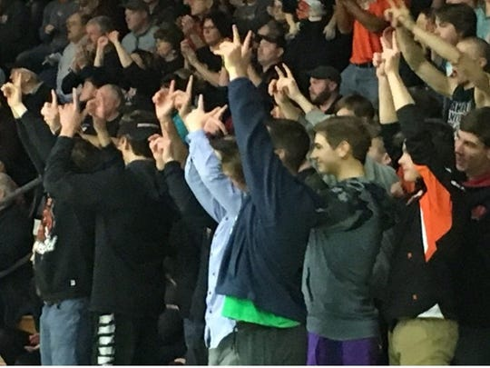 The Marshfield student section celebrate Tanner Kanable's win at 126 pounds during the Tigers WIAA Division 1 sectional meet against Hudson on Tuesday.