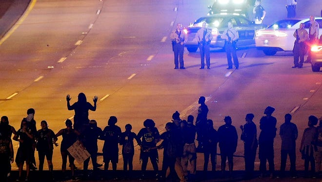 In this Sept. 22 photo, protesters block I-277 during a third night of unrest following the police fatal shooting of Keith Lamont Scott in Charlotte.