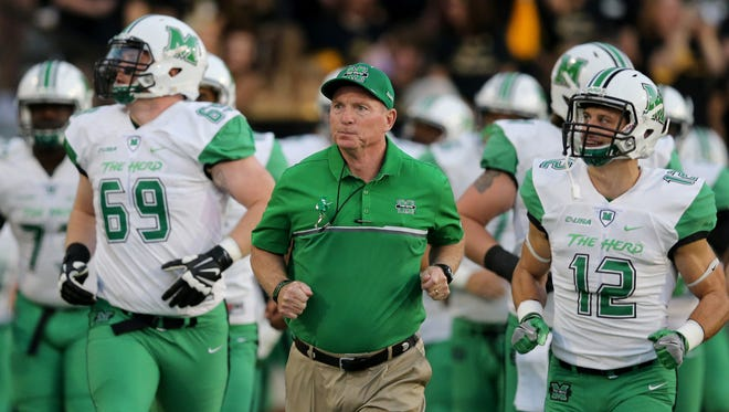 Marshall football coach Doc Holliday leads his team onto the field before an Oct. 29 game at Southern Mississippi. The Thundering Herd faces CSU on Saturday in the New Mexico Bowl.