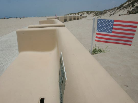 A U.S. flag is posted on a bench at Ed Hunt Rehab Point