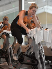 Beth Dryden pushes it during a spin class at Beverly