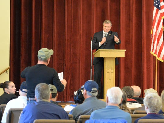 A veteran poses a question to Pa. Representative Charlie Dent during a Veterans Informational Program held at Palmyra First United Methodist Church on Saturday, May 21, 2016.