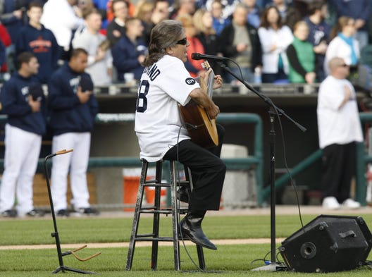 Jose Feliciano sings the national anthem in honor of Ernie Harwell prior to the game between the Detroit Tigers and the New York Yankees at Comerica Park, May 10, 2010, in Detroit.