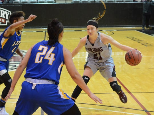 McMurry's London Weilert is defended by a pair of LeTourneau players during the War Hawks' 76-69 win in an American Southwest Conference matchup Thursday at Kimbrell Arena.