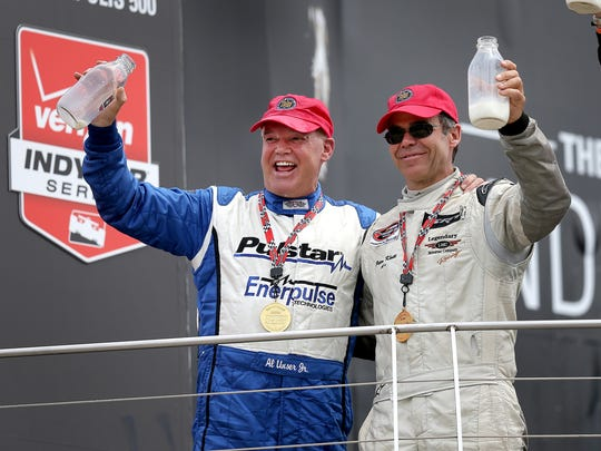 The Indy Legends Charity Pro/Am race on the final day of the Sportscar Vintage Racing AssociationÕs Brickyard Vintage Racing Invitational. The Pro/Am team of Al Unser Jr.,left, and Peter Klutt,right, celebrate their win in the Indy Legends Charity Pro/Am Sunday afternoon. Matt Kryger / The Star