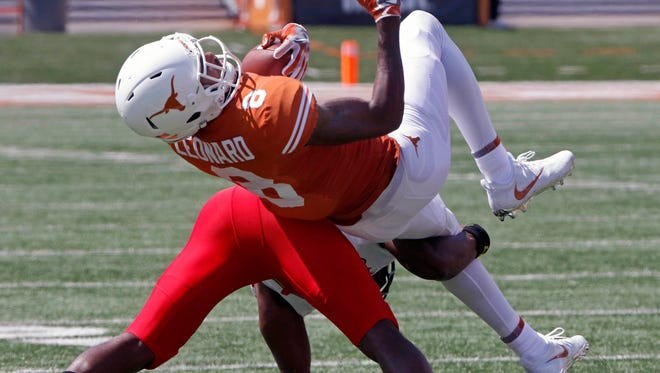 Texas receiver Dorian Leonard (8) is tackled by Maryland defensive back Antwaine Richardson during the first half.