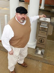 Boone County Clerk Kenny Brown introduces a drop box for motor vehicle renewals in 2014 so Walton residents didn't have to drive to the clerk's office.