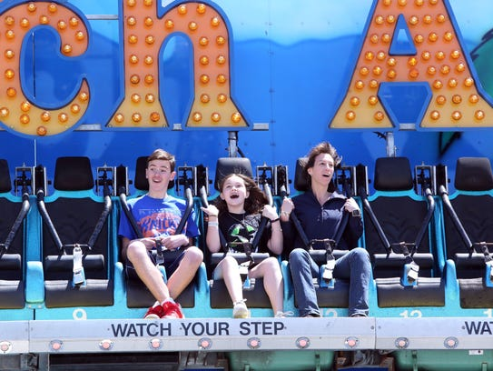 Elena Grossmann of New Hyde Park enjoys a Catch-A-Wave with son Chris, 13, and daughter Victoria, 11, on opening day at Playland on Mother's Day, May 14, 2017 in Rye.
