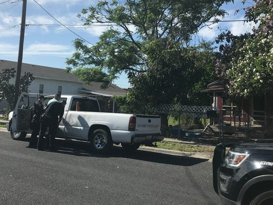 Two Corpus Christi police officers take a man into custody near Brownlee Boulevard on Thursday, March 29, 2018, during a prostitution operation.