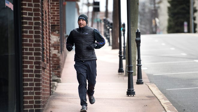 Endurance athlete Christian Griffith is running from the East Coast to the West Coast to raise awareness and $1 million to fight child sexual abuse. Here, Griffith runs on Main Street in Fort Lee on Tuesday, March 20, 2018.