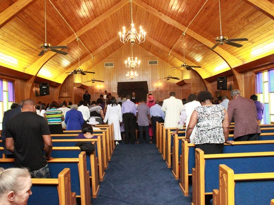 Congregation members celebrate the 89th anniversary of New Hope Baptist Church on Sunday.