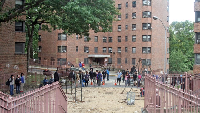 """Carmeras and crew are in place during the shooting of a scene of the HBO mini-series """"Show Me a Hero"""",  at the Schlobohm public housing project in Yonkers Oct. 1, 2014. The film tells the story of the Yonkers desegregation crisis of the 1980's."""