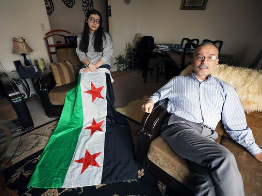 Liana Khairullah 15 with a pre-Assad Syrian flag sitting with her father, Dr. Fehmi Khairullah, with the Syria First Coalition. Dr. Khairullah says that Syria President Bashar al-Assad is a criminal who needs to be overthrown.