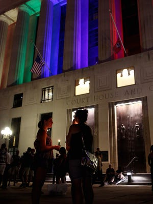 The Public Square Courthouse is lit in rainbow colors following  a vigil held Sunday June 12, 2016 in honor of the victims of the Orlando attack.