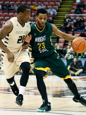 Wright State's Mark Alstork (23) drives against Oakland's Kay Felder (20) during the first half of Oakland's loss in the Horizon League tournament semifinal at Joe Louis Arena.