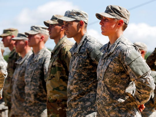 U.S. Army First Lt. Shaye Haver, right, stands in formation