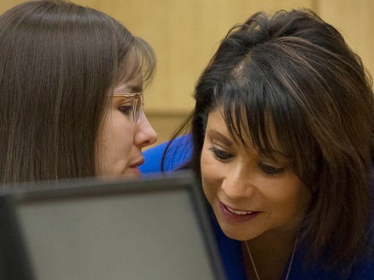 Jodi Arias (left) talks Maria De La Rosa during Arias' trial in April 2013.