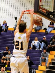 Wylie senior Dylan Isenhower dunks the ball against