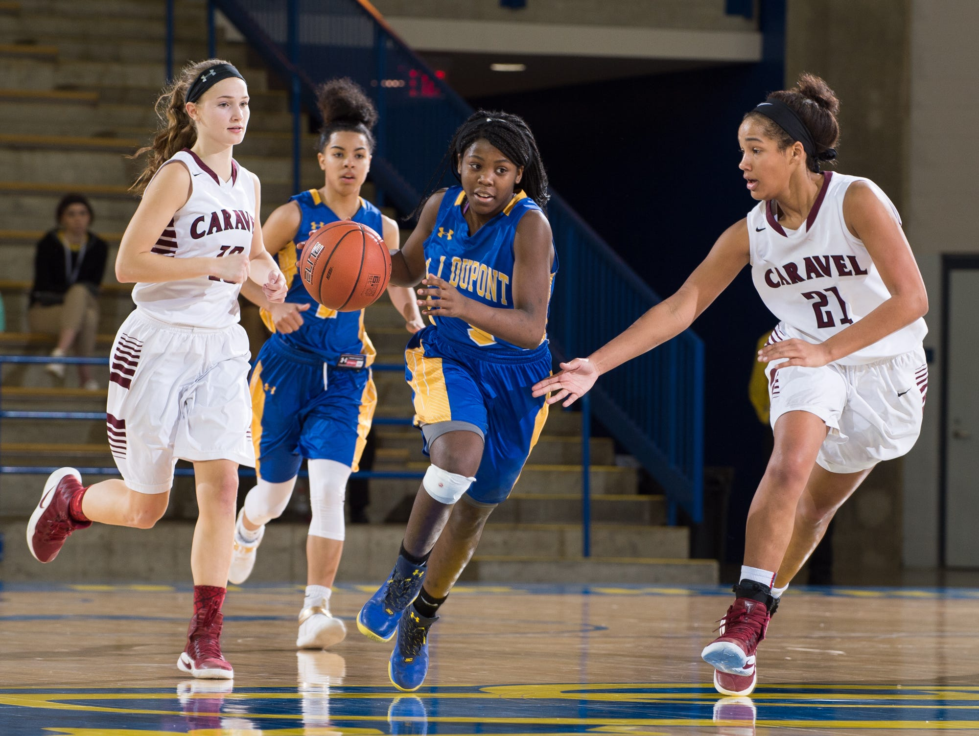 A.I. duPont's Ber'Nyah Ward-Mayo (3) dribbles down the court in the quarterfinals of DIAA Girls Basketball Tournament at the University of Delaware against Caravel.