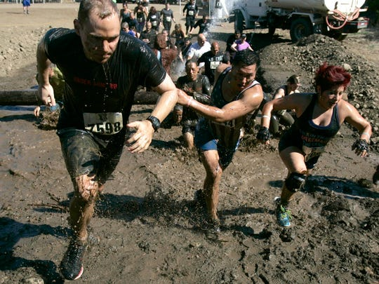 Contestants take off through the first mud puddle in the Krusher Mud Run at the KOA campground in Santa Paula.