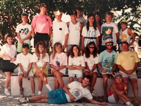 FLORIDA TODAY's Tim Walters, top left in green shorts, with the Divine Mercy Catholic School graduating eighth grade class in 1991 on a trip to a sea camp in the Florida Keys. Lying across the bottom is science teacher Scott Guisbert.