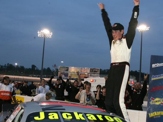 Joey Logano, at 15, raises his arms in celebration
