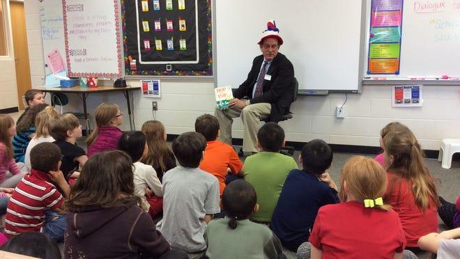 Wausau Mayor Jim Tipple reads to third-grade students at G.D. Jones Elementary School.