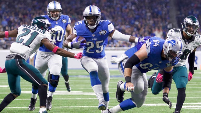 Oct 9, 2016; Detroit, MI, USA; Detroit Lions running back Theo Riddick (25) moves in for a touchdown run against Philadelphia Eagles defensive back Leodis McKelvin (21) during the first quarter at Ford Field. Mandatory Credit: Raj Mehta-USA TODAY Sports