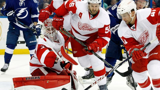 Detroit Red Wings goalie Jimmy Howard keeps his eye on the puck against the Tampa Bay Lightning during the second period at Amalie Arena on March 20, 2015.
