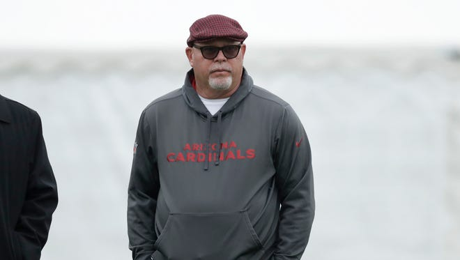 Arizona Cardinals head coach Bruce Arians supervises an NFL training session at the London Irish rugby team training ground in the Sunbury-on-Thames suburb of south west London, Wednesday, Oct. 18, 2017. The Arizona Cardinals are preparing for an NFL regular season game against the Los Angeles Rams in London on Sunday. (AP Photo/Matt Dunham)