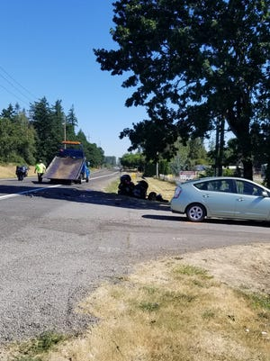 Deputies say a woman turned in front of an oncoming motorcyclist Thursday morning.