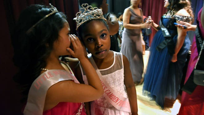 """The 2nd Annual Cinderella Sweetheart Ball was held at the Susquehanna Bank Center on Saturday, March 21st. For  Miss Camden Teen Pageant president Caress Green--who mentors the girls and boys involved in her program year-round-- the event was """"a night of elegance,"""" to introduce her royal court of Camden to families, friends and supporters.  The current Little Miss Camden Princess, Zhashiya Ali, hears a secret from Nadia Sandoval before the ball begins.   Photos by April Saul"""