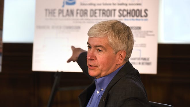 Michigan Governor Rick Snyder announced on Thursday April 30, 2015 plans to create a new debt-free Detroit public school district during a news conference at State offices in Detroit. (Max Ortiz/The Detroit News) 2015