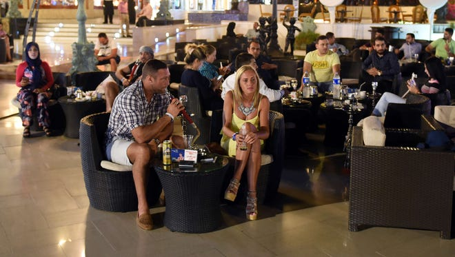 Tourists relax at a café in  Sharm el-Sheikh on Friday.