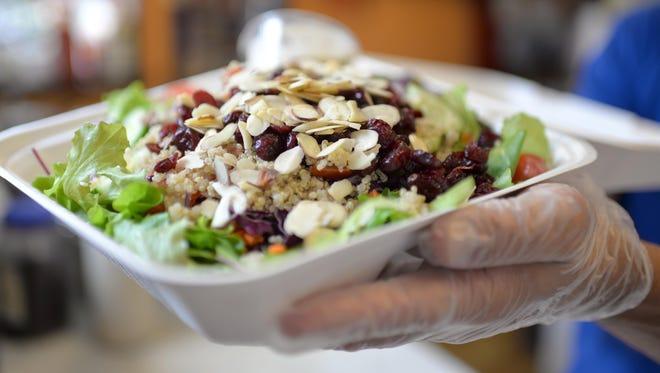 "Wildflower Vegan's cranberry-almond ""honey"" mustard power salad, Wednesday, Jun. 1 2016 in Millville."