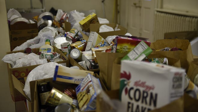 Groceries are packaged at the food bank inside the Douglas Memorial Community Church in Baltimore.