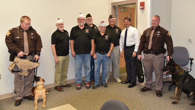 Members of the Veterans of Foreign Wars Post 1108 presented Sheriff Jeff Cappa with protective vests for the agency's two K-9 officers, Ozzy and Agar.