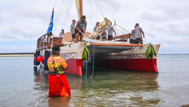"Traditional ocean navigator Ignacio ""Nash"" Camacho assists the ocean-sailing vessel, Okeanos Marianas, in tying up to the rocks along the shore at the Hagåtña boat basin on Tuesdsay, Nov. 14, 2017."