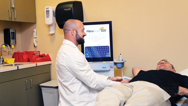 A patient at Desert AIDS Project in Palm Springs undergoes a FibroScan,  which helps detect liver damage from Hepatitis C.