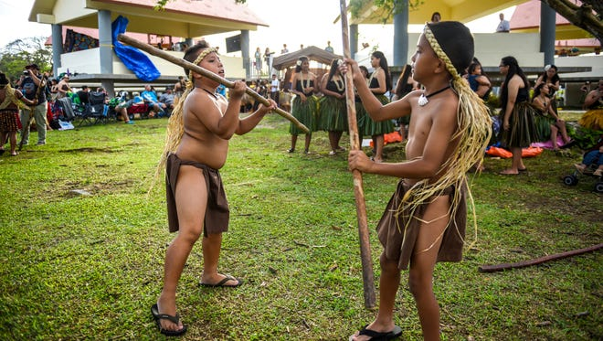 Local cultural dancers ready themselves for the opening ceremony of the 30th annual Guam Micronesia Island Fair at the Paseo in Hagåtña on Wednesday, May 2, 2018. The fair will feature the unification of Guam and the neighboring islands of the Commonwealth of the Northern mariana Islands, Chuuk, Kosrae, Pohnpei, Yap, Palau and the Marshall Islands, as well as the sharing of their culture, practices and dance.