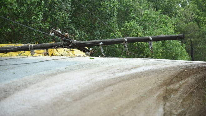 Downed power lines and fallen utility poles gave reason for emergency personnel to close a section of Route 17, also known as Cross Island Road, after the passage of tropical Storm Maria on Thursday, July 5, 2018.