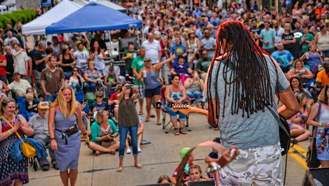 Pita Katobalavu, co-founder of Midwest Sunsplash, performs with Unity the Band during the 2017 event in Menasha.