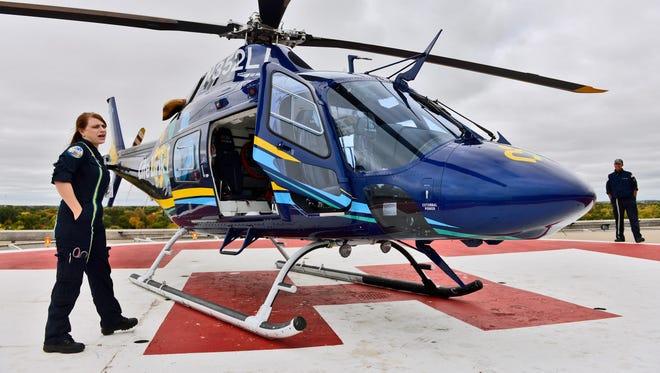 Life Link III Flight Nurse Twyla Bergenstal (left) talks about their new, $4.8 million AgustaWestland 119Kx Koala helicopter on the helipad Sept. 29 at St. Cloud Hospital. Looking on is paramedic Phil Nicolas.