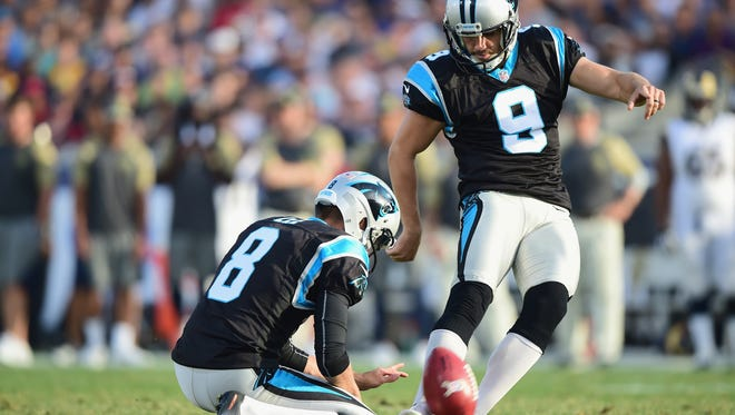 LOS ANGELES, CA - NOVEMBER 06:  Kicker Graham Gano #9 of the Carolina Panthers makes a field goal held by teammate Andy Lee #8 for a 10-0 lead in the third quarter of the game against the Los Angeles Rams at the Los Angeles Coliseum on November 6, 2016 in Los Angeles, California.  (Photo by Harry How/Getty Images)