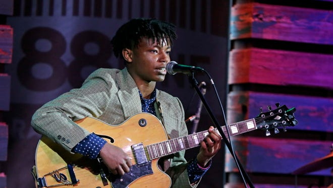 Kwasi Stampley, a 15-year-old sophomore from the University School of Milwaukee, performed an improvisational jazz song on electric guitar at the Music Lab Friday.