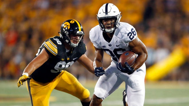 Penn State running back Saquon Barkley, right, runs past Iowa defensive end Anthony Nelson during the first half of an NCAA college football game Saturday, Sept. 23, 2017, in Iowa City, Iowa. (AP Photo/Jeff Roberson)